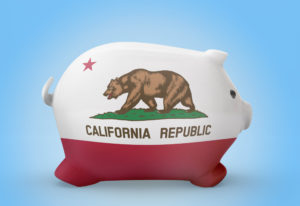side view of a piggy bank with the flag design of California.