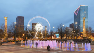 Centennial Olympic Park and surrounding buildings in Atlanta at night