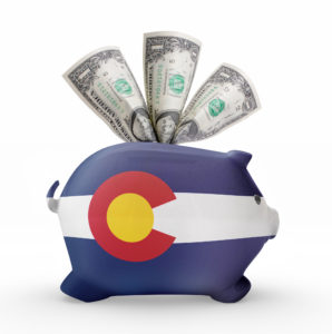 Side view of a piggy bank with the flag design of colorado.