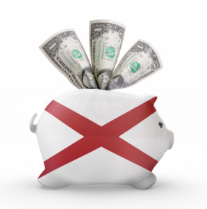 Side view of a piggy bank with the flag design of Alabama.