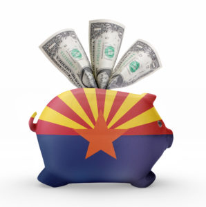 Side view of a piggy bank with the flag design of Arizona