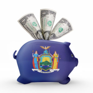 Side view of a piggy bank with the flag design of New York.