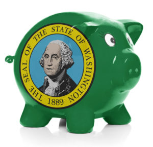 Piggy bank with flag coating over it isolated on white - state of Washington