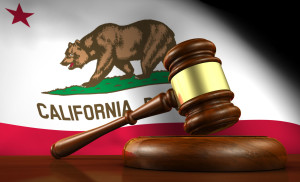 This is a picture of a California flag with a gavel in front of it.